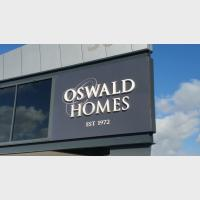 oswald homes window sign