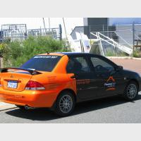 Car with black and orange signs